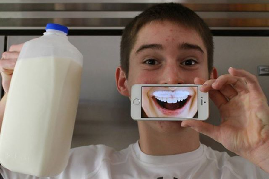 Marshall+uses+his+iPhone+in+his+milk+mustache+photo.+He+was+the+ultimate+winner+of+the+scholarship%2C+and+was+awarded+%2412%2C000+for+college.+