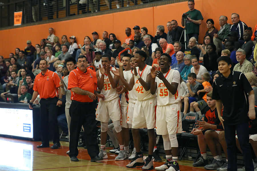Boys basketball prevails in first-round playoff test