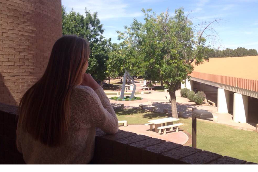 A student observes the interior campus. Next year, all the hills and trees will be removed.