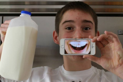 Marshall uses his iPhone in his milk mustache photo. He was the ultimate winner of the scholarship, and was awarded $12,000 for college.