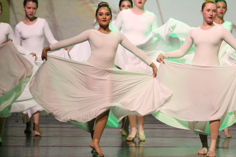 Junior Keila Chavarria dances to the front of the stage