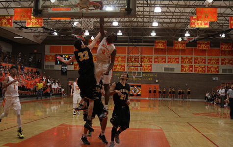 Senior guard Saben Lee dunks against Gilbert in the final regular season home game of his junior year. Lee verbally committed to Vanderbilt following a visit in June.