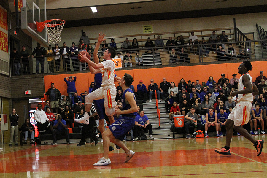 Senior guard Alex Barcello goes in for a layup in a quarterfinal matchup against Westview. The Aztecs beat the Knights, 73-57, and move on to face Cesar Chavez in the semifinals.