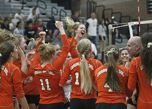 Girls Volleyball celebrates their win over Perry in the state semifinals. They will face Xavier in the state finals. Photo by Coree Thrun.